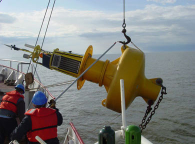 A buoy, equipped with scientific gear, is retrieved from the lake.